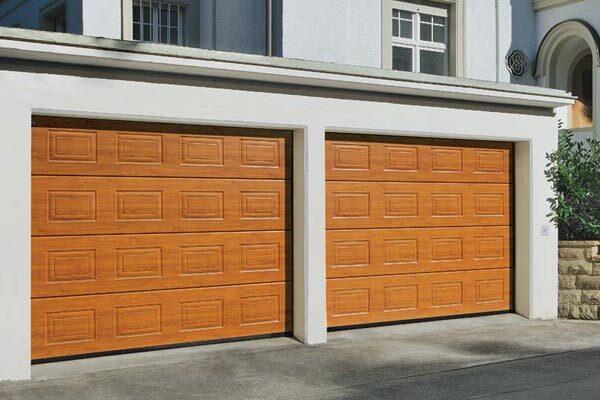 Nos portes de garage fermeture sur mesures val de marne for Porte garage bois sectionnelle